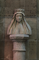 Bust of Marie d'Anjou, 1404-63, queen of France and wife of Charles VII, marble, made in 1463, on loan from the Musee du Louvre, Paris, in the Basilique Saint-Denis, Paris, France. The basilica is a large medieval 12th century Gothic abbey church and burial site of French kings from 10th - 18th centuries. Picture by Manuel Cohen