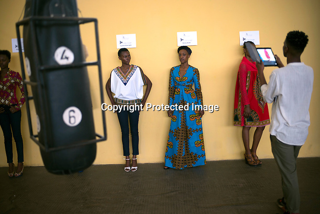 JULY 23: Model do fittings for the Bombix by Rose Bombo label a few days before Kinshasa Fashion Week on July 23, 2015, at the boxing gym at Shark club in Kinshasa, DRC. Local and invited foreign-based designers showed their collections during the 2015 edition of Kinshasa Fashion week. (Photo by Per-Anders Pettersson)
