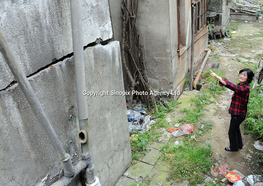 Buildings are cracked in the Huang Gu Po district of Badong on the lower reaches of the Three Gorges Dam.  Several of the new cities are suffering from structural damage due to land and earth movements caused by the 400 kmThree Gorges reservoir..27 May 2010