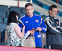 Craig Levein takes his seat in the stand.