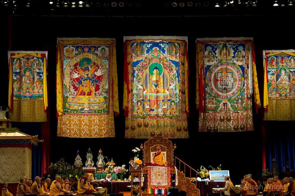 The Dalai Lama giving Kalachakra teachings at the Verizon center, 2011, as the Karmapa Lama watches.