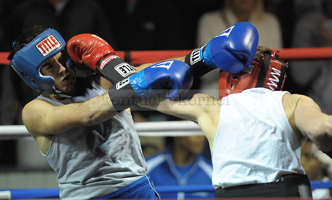 Josiah Hanna (left) from Triangle fights Benton Hupman (right) from Phi Delta Theta at the Sigma Chi Fraternity & Alpha Delta Pi Sorority sponsored The Main Event 2011 in Lexington, Ky. Benton Hupman won the fight. Photo by Mike Weaver | Staff