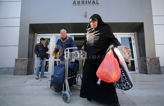 Palestinians, come back from Egypt, arrive passport control point at the Rafah Border crossing in Rafah, Gaza on February 18, 2017 as the border gate temporarily reopened for one day by Egyptian authority for both directions. Photo by Ashraf Amra