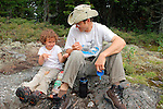 Uncle Tolston and Ellie, age 5, eating snack on Burnt Jacket Mountain.