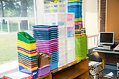 Schenectady, NY. Zoller Elementary School (urban public school). Kindergarten classroom. Piles of containers stacked on bookshelves in classroom. ID: AM-gKw. © Ellen B. Senisi.