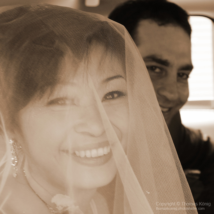 Taiwanese Wedding -- The happy couple in the wedding car.