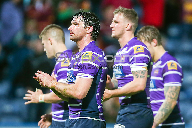 Picture by Alex Whitehead/SWpix.com - 29/05/2014 - Rugby League - First Utility Super League - Huddersfield Giants v Wigan Warriors - John Smith's Stadium, Huddersfield, England - Wigan's Matty Smith and team-mates thank the travelling support.