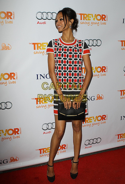 Zoe Saldana.Trevor Live at The Hollywood Palladium in Hollywood, California, USA..December 4th, 2011.full length dress clutch bag white black red print profile .CAP/ADM/KB.©Kevan Brooks/AdMedia/Capital Pictures.