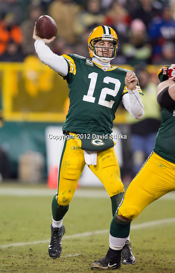 Green Bay Packers quarterback Aaron Rodgers (12) throws a pass during an NFL divisional playoff football game against the New York Giants on January 15, 2012 in Green Bay, Wisconsin. The Giants won 37-20. (AP Photo/David Stluka)
