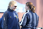 Santa Barbara, CA 02/19/11 - Jen Dunbar of Michigan chats with an assistant coach before the game against UC Davis.