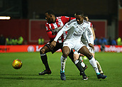 2nd December 2017, Griffen Park, Brentford, London; EFL Championship football, Brentford versus Fulham; Josh Clarke of Brentford runs passed Ryan Sessegnon of Fulham