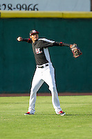 Hickory Crawdads left fielder Jairo Beras (32) throws the ball back to the infield during the game against the Charleston RiverDogs at L.P. Frans Stadium on June 2, 2014 in Hickory, North Carolina.  The Crawdads defeated the RiverDogs 9-6.  (Brian Westerholt/Four Seam Images)