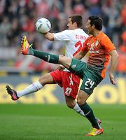 FUSSBALL   1. BUNDESLIGA   SAISON 2011/2012   29. SPIELTAG 1. FC Koeln - SV Werder Bremen                           07.04.2012 Christian Clemens (hinten, 1. FC Koeln) gegen Claudio Pizarro (vorn, SV Werder Bremen)