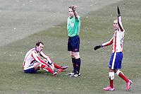 Atletico de Madrid's Diego Godin injured in presence of spanish referee Fernandez Borbalan and Joao Miranda during La Liga match.February 7,2015. (ALTERPHOTOS/Acero) /NORTEphoto.com