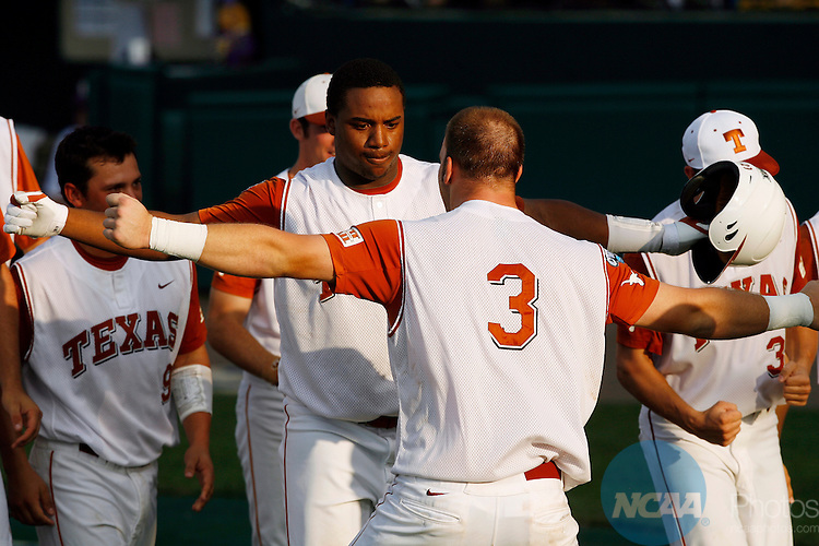 22 JUNE 2009:  Kevin Keyes (29) of the University of Texas is congratulated after hitting the third of three home runs hit in the 4th inning against Louisiana State University during the Division I Men's Baseball Championship held at Rosenblatt Stadium in Omaha, NE.  LSU defeated Texas 7-6 in the first game of the series.  Jamie Schwaberow/NCAA Photos