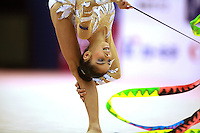 Filipa Siderova of Bulgaria waves with ribbon during back flexion at 2006 Aeon Cup Worldwide Club Championships in rhythmic gymnastics on November 16, 2006 at Mie, Japan.<br />