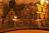 The barrel aging cellar and a table with candles. Bodega Juanico Familia Deicas Winery, Juanico, Canelones, Uruguay, South America