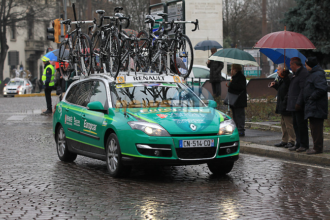 Europcar Team car behind the pelethon as they pass through Pavia during the 104th edition of the Milan-San Remo cycle race, 17th March 2013 (Photo by Eoin Clarke 2013)