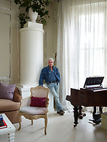 A portrait of interior designer Nicky Haslam in his London apartment.