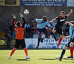 Lee McCulloch beats Marvin Andrews to power a header towards goal
