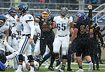 BROOKINGS, SD - DECEMBER 3:  Ryan Earith #90 and Cole Langer #54 from South Dakota State celebrate stopping Villanova on fourth down during their second round playoff game Saturday afternoon at Dana J. Dykhouse Stadium in Brookings, SD. (Photo by Dave Eggen/Inertia)