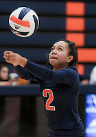 NWA Democrat-Gazette/CHARLIE KAIJO Rogers Heritage High School Berenice Morales (2) digs during a volleyball game, Thursday, October 11, 2018 at Rogers Heritage High School in Rogers.