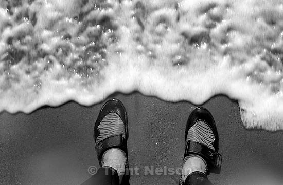 Trent feet at the ocean and wave<br />
