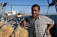TUNISIA island Kerkennah, sponge diver, fishing boat Monastir II, captain Hassan Ben Belgassen, sponge is a sea animal, diver collect the spong from sea ground in 20 Meter depth, after washing and cleaning the skeleton is sold as bath sponge / TUNESIEN Insel Kerkenna, Schwammtaucher Monastir II im Mittelmeer, der Schwamm ist ein Meerestier, Taucher holen den Schwamm vom Meeresboden aus ca. 20 Meter Tiefe, nach Auswaschen der Zellen erscheint das Skelett, das als Badeschwamm vermarket wird