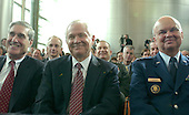 """Washington, D.C. - February 20, 2007 -- Federal Bureau of Investigation (FBI) Director Robert Mueller, left, United States Secretary of Defense Robert Gates, center, and Central Intelligence Agency (CIA) Director Michael Hayden, right, smile as United States President George W. Bush makes remarks prior to the Ceremonial Swearing-in for retired Vice Admiral John Michael """"Mike"""" McConnell as the second Director of National Intelligence (DNI) in Washington, D.C. on Tuesday, February 20, 2007.  McConnell replaces John Negroponte.<br /> Credit: Ron Sachs - Pool"""