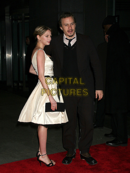 "MICHELLE WILLIAMS & HEATH LEDGER.""Brokeback Mountain"" New York Premiere at Loews Lincoln Square, New York City..December 6th, 2005.Ref: IW.full length white dress black clutch purse celebrity couple boyfriend girlfriend black suit.www.capitalpictures.com.sales@capitalpictures.com.©Capital Pictures"