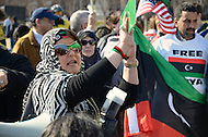 "Washington, DC. March 12, 2011. With banners flying high, and chants of ""Free Libya Now"", Libyans in America show solidarity with those still struggling in Libya.  As Gaddafi clings to power, such protests have grown since chaos has erupted in Libya. (Photo: Don Baxter/Media Images International)"