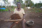 Grace Janje winnows termites --separating the wings from the edible body -- in a camp for more than 5,000 displaced people in Riimenze, in South Sudan's Gbudwe State, what was formerly Western Equatoria. Families here were displaced at the beginning of 2017, as fighting between government soldiers and rebels escalated.<br /> <br /> Two Catholic groups, Caritas Austria and Solidarity with South Sudan, have played key roles in assuring that the displaced families here have food, shelter and water.<br /> The camp formed around the Catholic Church in Riimenze as people fled violence in nearby villages for what they perceived as the safety offered by the church.