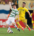 Celtic's Tierney is caught by Moi Gomez .