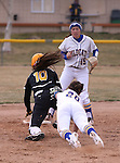 Western Nevada College Wildcats' Makaylee Jaussi dives to tag out College of Southern Idaho's Brittany Bland during a game at Edmonds Sports Complex, in Carson City, Nev., on Friday, Feb. 27, 2015.  <br /> Photo by Cathleen Allison/Nevada Photo Source