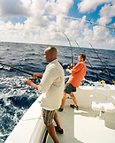 USA, Florida, men catching fish on the back of a boat, Islamorada
