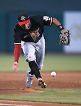 Albuquerque Isotopes' Joey Wong barehands a ball down the third baseline in a game against the Reno Aces in Reno, Nev., on Saturday, April 18, 2015. The Isotopes won 9-4.<br /> Photo by Cathleen Allison