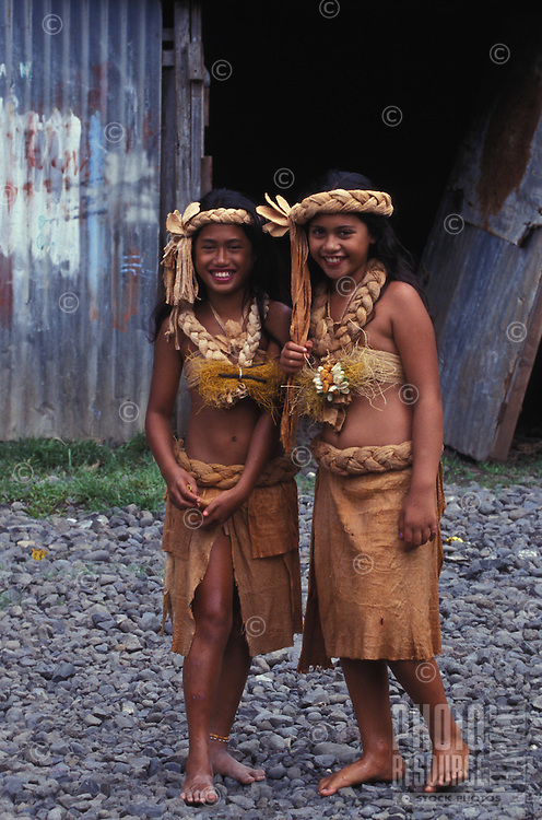 two young girls in traditional hula costume at a hula heiva festival, Fatu Hiva, Marquesas, French Polynesia