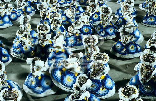 Rio de Janeiro, Brazil. Carnival; swirling sambistas in blue, white and yellow hooped dresses.