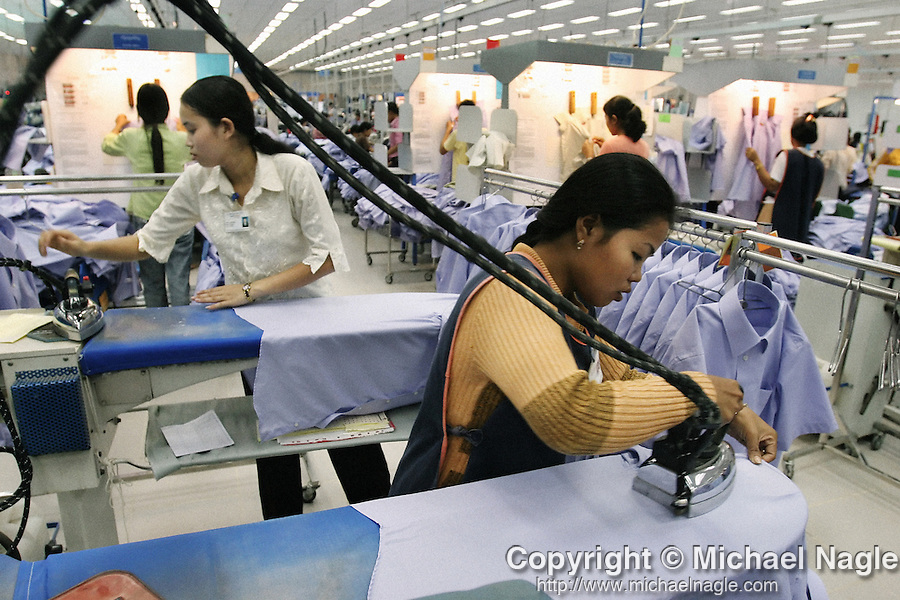 CAMBODIA  -  APRIL 08, 2005:  Garment workers at the New Island Factory in Phnom Penh on April 08, 2005 in Cambodia. The World Trade Organization recently abolished textile quotas and, as a result, some of the world's smallest and least developed countries like Cambodia will see their textile industries pushed out to the periphery. Moreover, in 2005, a unique agreement that grants Cambodian garments and textiles exclusive access to lucrative US markets will expire, opening up the garment industry to competition with every other manufacturing country in the world.  (PHOTOGRAPH BY MICHAEL NAGLE)