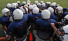New Hyde Park varsity football teammates gather together during practice at Tully Park on Monday, August 24, 2015.<br /> <br /> James Escher