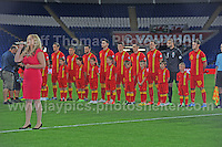 The National anthem is sung as the Welsh team line up before the Wales v Serbia FIFA World Cup 2014 Qualifier match at Cardiff City Stadium, Cardiff, Wales -Tuesday 10th Sept 2014. All images are the copyright of Jeff Thomas Photography-07837 386244-www.jaypics.photoshelter.com