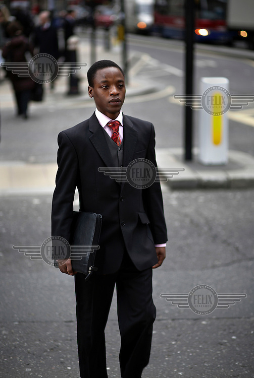 Duncan Makoni, a self-employed trader, on his way to a meeting in the City of London. The UK went into recession in the final quarter of 2008 as the City was hit hard by the global credit crunch.