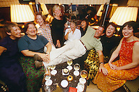 """Fellow passengers of the Road to Mandalay celebrate Irwin """"Irv"""" Jaeger, who just returned from his solitary trip to the leg-rowers of Inle Lake."""