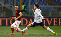 Calcio, Serie A: Roma vs Fiorentina. Roma, stadio Olimpico, 4 marzo 2016.<br /> Roma&rsquo;s Alessandro Florenzi, left, is challenged by Fiorentina&rsquo;s Marcos Alonso during the Italian Serie A football match between Roma and Fiorentina at Rome's Olympic stadium, 4 March 2016.<br /> UPDATE IMAGES PRESS/Riccardo De Luca