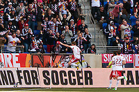Dax McCarty (11) of the New York Red Bulls celebrates scoring. The New York Red Bulls defeated the Philadelphia Union 2-1 during a Major League Soccer (MLS) match at Red Bull Arena in Harrison, NJ, on March 30, 2013.