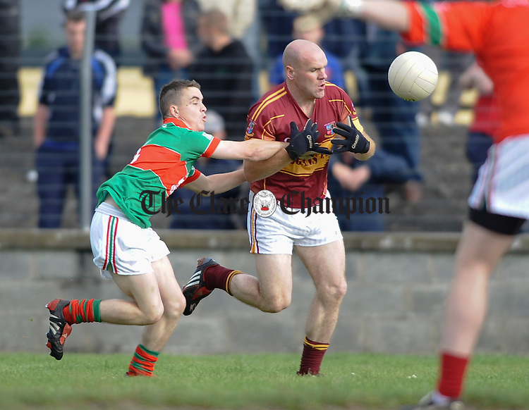Kilmurry Ibrickane's Martin Mc Mahon and Miltown's Dessie Molohan in action during their Cusack Cup sem-final game against Miltown Malbay at Kilmihil. Photograph by John Kelly.