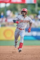 Adolis Garcia (32) of the Memphis Redbirds hustles to third base against the Salt Lake Bees at Smith's Ballpark on July 24, 2018 in Salt Lake City, Utah. Memphis defeated Salt Lake 14-4. (Stephen Smith/Four Seam Images)