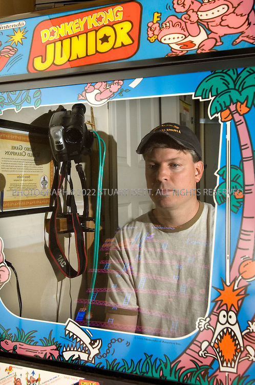 "8/1/2007--Redmond, WA, USA..Steve Wiebe plays Donkey Kong in his garage in Redmond, WA. Wiebe stars in an upcoming documentary, ""King of Kong"", about two grown up men and their rivalry to acheive the world record high score on the 1980's arcade game Donkey Kong. ..(NOTE: the machine in Wiebe's garage says 'Donkey Kong Junior' on the sides but the game is the original Donkey Kong)...Photograph ©2007 Stuart Isett.All rights reserved"
