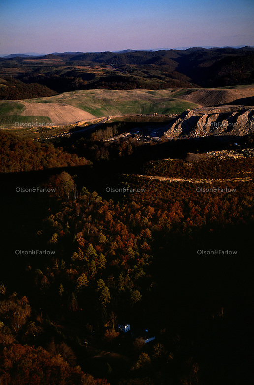 An aerial picture reveals a large mountaintop removal mine that sits directly over homes in Logan County.