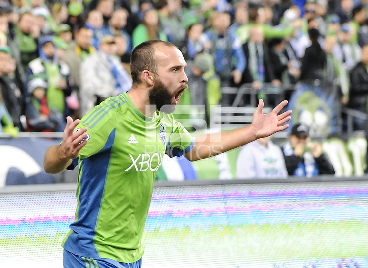 November, 2013: CenturyLink Field, Seattle, Washington:  Seattle Sounders FC midfielder Adam Moffat (26) expresses his frustration as the Portland Timbers defeat  the Seattle Sounders FC 2-1 in the Major League Soccer Playoffs semifinals Round.